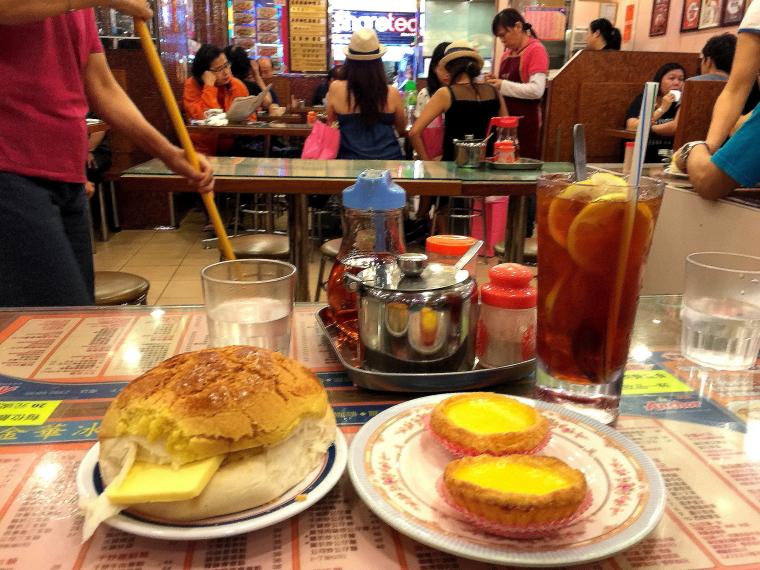 Polo bun and egg tarts at Kam Wah Cafe, Bute Street, Mongkok, Hong Kong